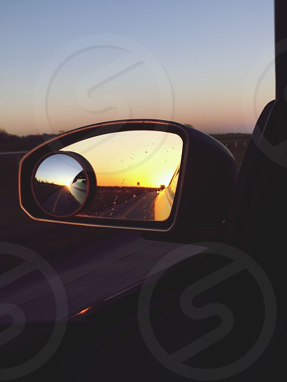 Sunset from car mirror on an everyday drive photo