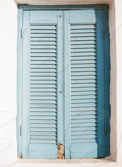 geometric shapes blue lines shutters window wood cement photo