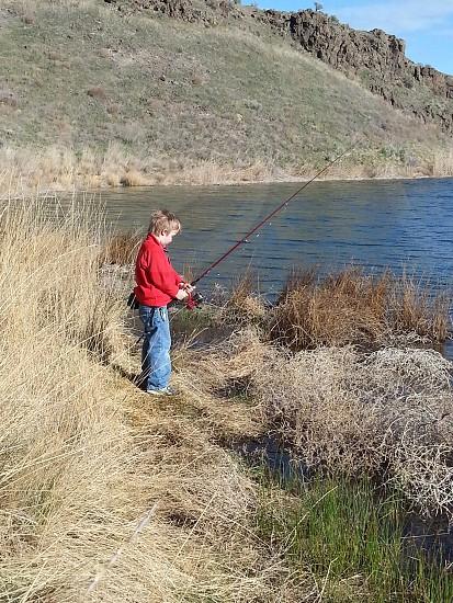 Fishing boy lake Pot Holes State Park Washington State Moses Lake photo