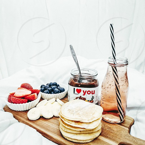 pancake in front i love you chocolate jar  beside blueberry and raspberry photo