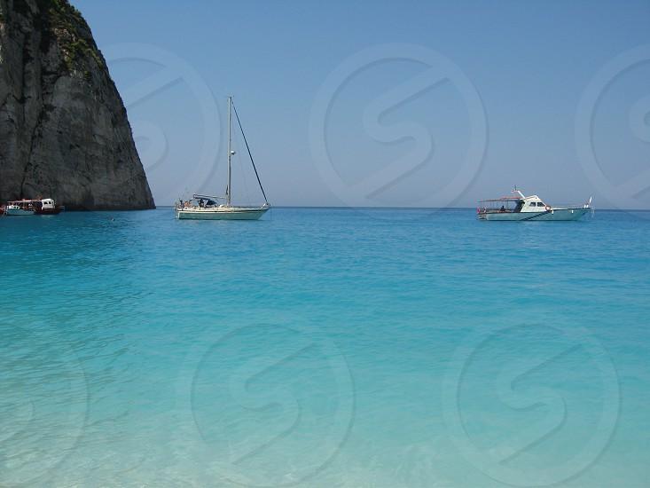 Yachts on beautiful beach photo