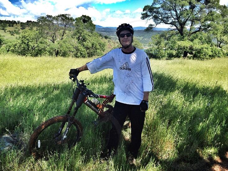 Man with mountain bike / downhill photo