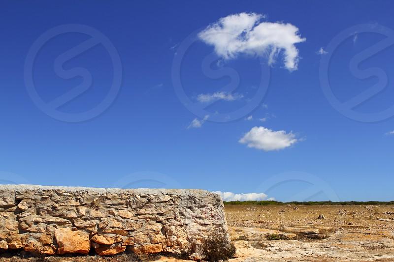 Formentera balearic island stone masonry blue sky summer landscape photo