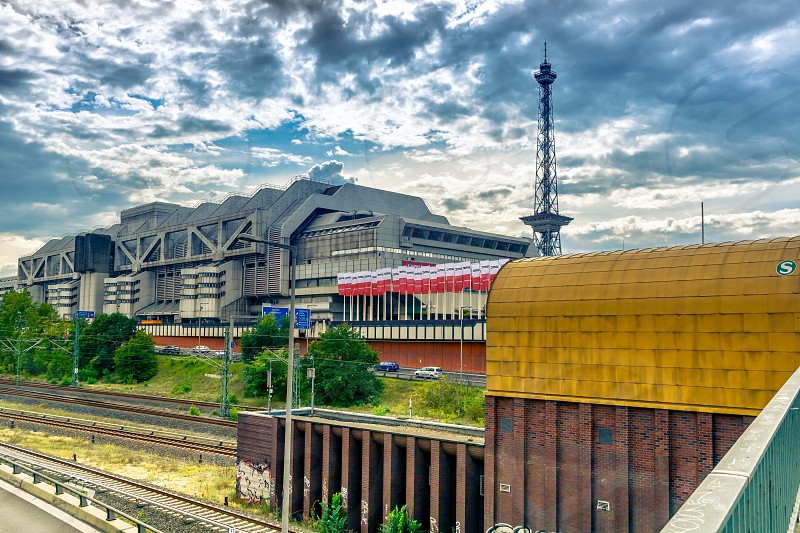 View landscape cityscape city architecture town sky skyline clouds industrial railway building tower radio colorful yellow transportation industry travel dramatic tranquility wind high contrast urban style outdoor nobody  photo