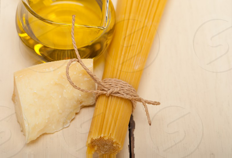 Italian pasta basic food ingredients parmesan cheese and extra virgin olive oil photo