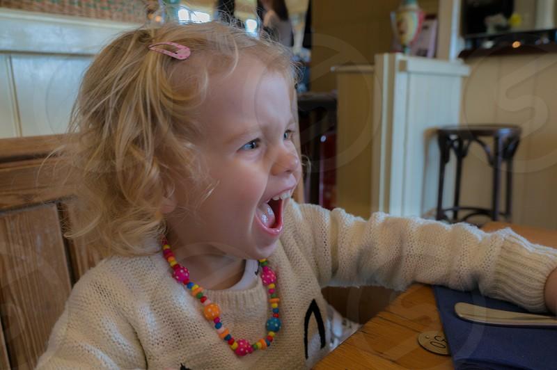 fun laugh playful girl pub table photo