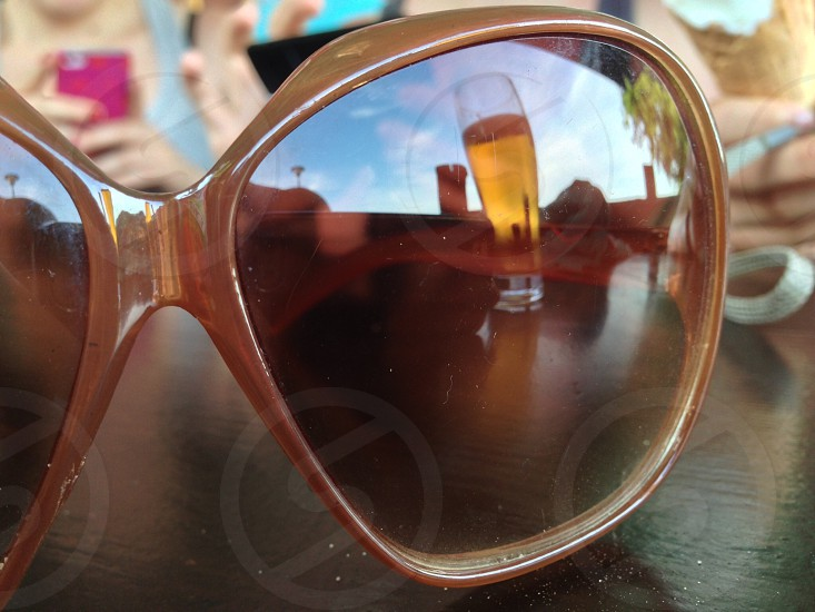 Beer reflecting in a pair of sunglasses. photo