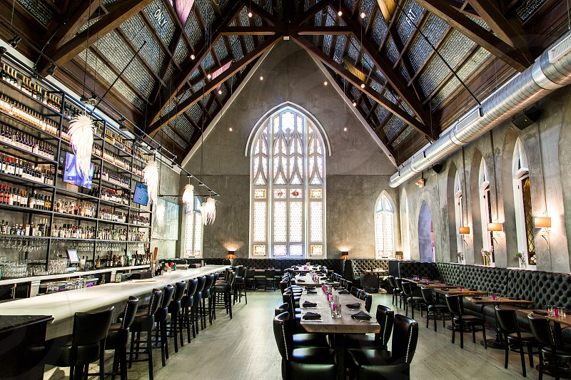 Interior of 5Church wide open space old church building themed stained glass bar area and art. photo