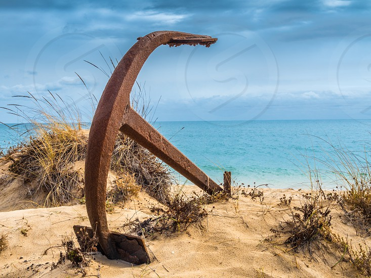 Natural Cemetery of Marine Anchors at Barril Beach near Tavira on the southern Portuguese coast of the Atlantic. photo