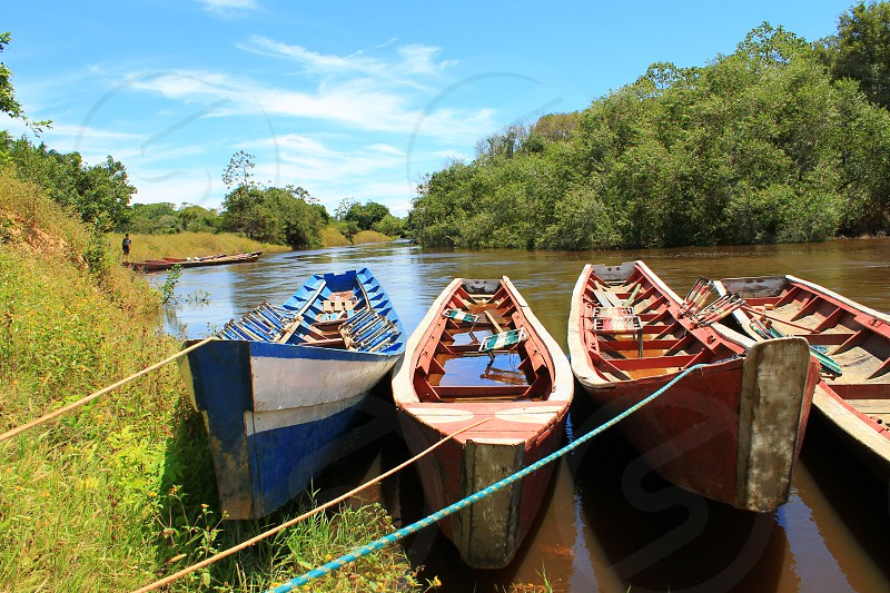 4 boats parked photo