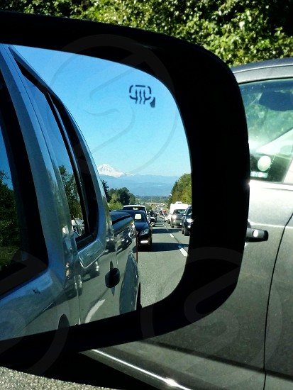 Mt Baker WA view in mirror Ford F150 traffic snow covered mountain summer travel adventure explore landscape view photo