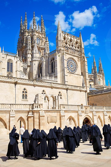 Burgos Cathedral facade in Saint James Way with unknown nuns at Castilla Leon of Spain photo