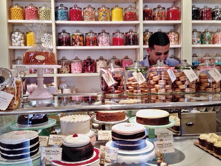 cakes on clear glass display shelf photo