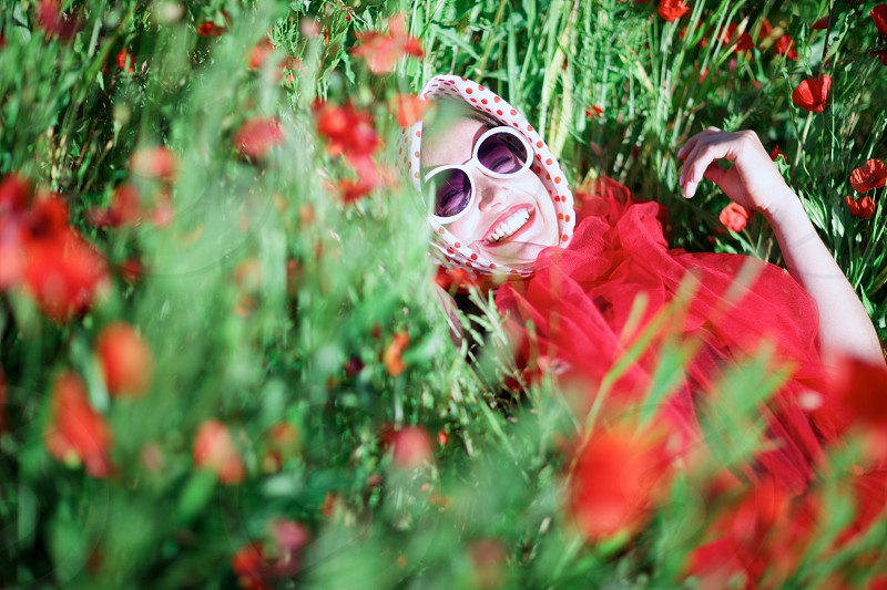 Funky girl in the poppy meadow photo