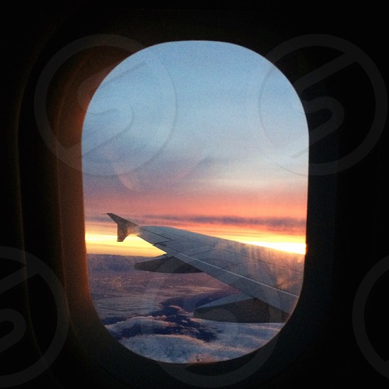view of airplane wing at sunrise photo