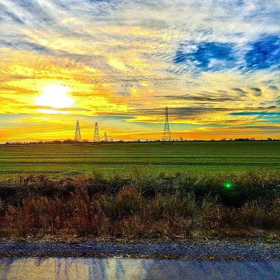 green grassland in sunrise view photo