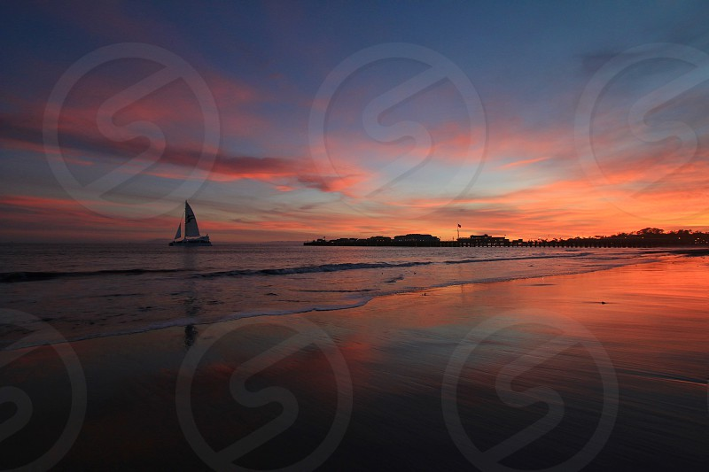 sail boat on a beach during dawn photo