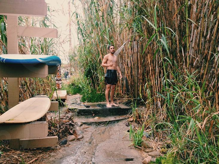 man taking shower photography photo