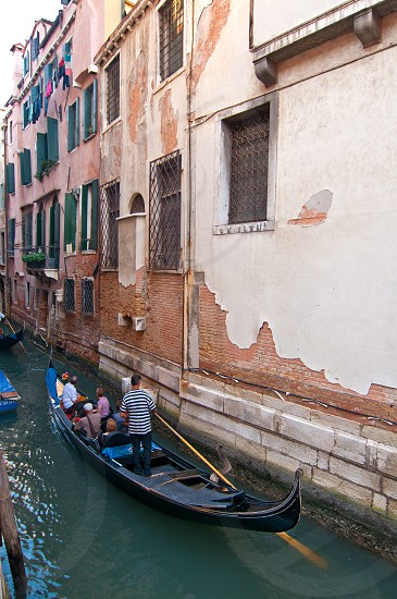 Venice Italy Gondolas on canal  most famous boat  photo