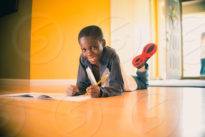African American boy doing homework. photo