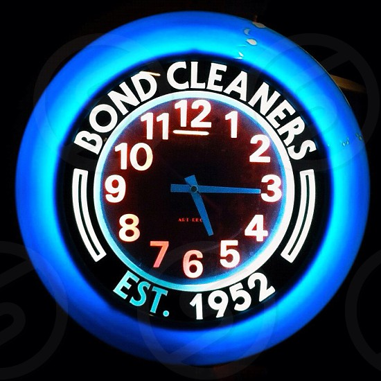 bond cleaners wall clock 5:15 photo
