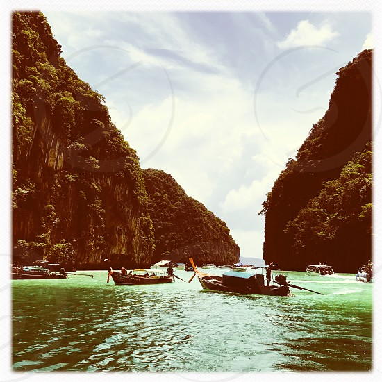 Outdoor day colour square filter Phi Phi Islands Maya Bay limestone cliffs rocks sea ocean water Krabi National Park Thailand Thai kingdom east eastern Orient beach turquoise blue azure tropical paradise sky Summer summertime clouds travel wanderlust tourism tourist vibrant vivid wood Nature natural boat boats colourful emerald green lush vegetation greenery photo