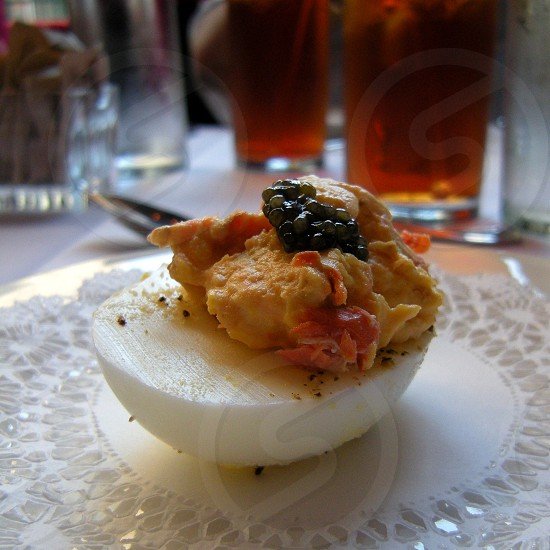 Crawfish filled deviled egg topped with caviar photo