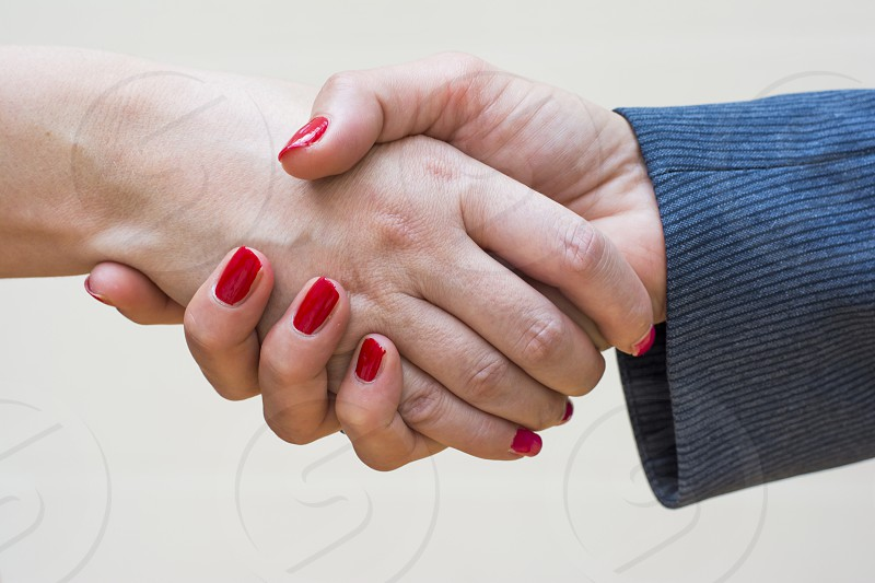 Handshake of two business women after closed deal photo