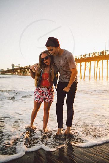 couple on seashore photo