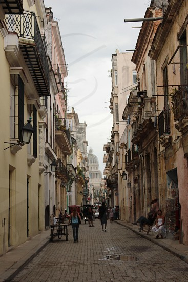 Havana Cuba the old national capitol building framed by the tightly packed streets and pathways of Havana old town photo