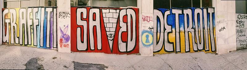 assorted graffiti on white walls photo
