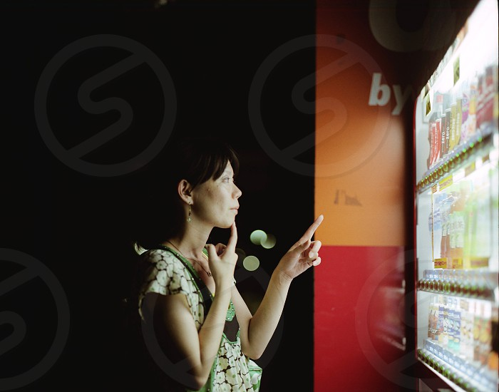 woman choosing drinks people photography  photo