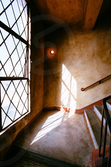 rustic stairs and glass window photo