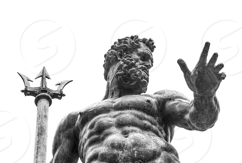 Italy Bologna BO - April 2 2016-photograph from the bottom of the sculpture of Neptune located in Piazza Maggiore Bologna.----------:Artistic sculpture of Neptune statue photographed in black and white. photo