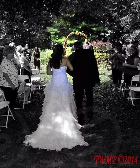 A bride and her grandfather walking down the isle partial color  photo