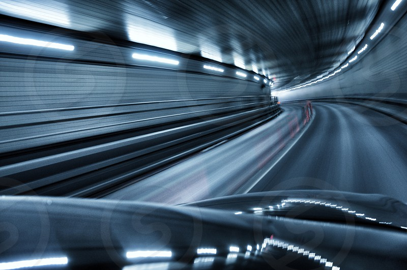 time-lapse photography of car riding on tunnel photo
