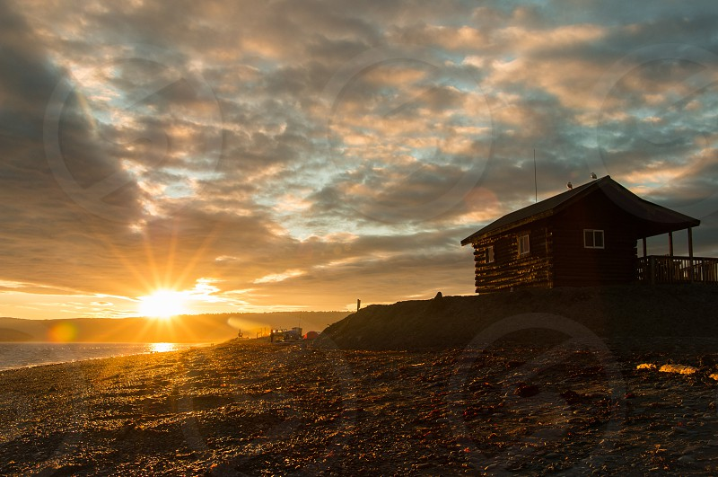 Cabin on the beach at sunset? photo