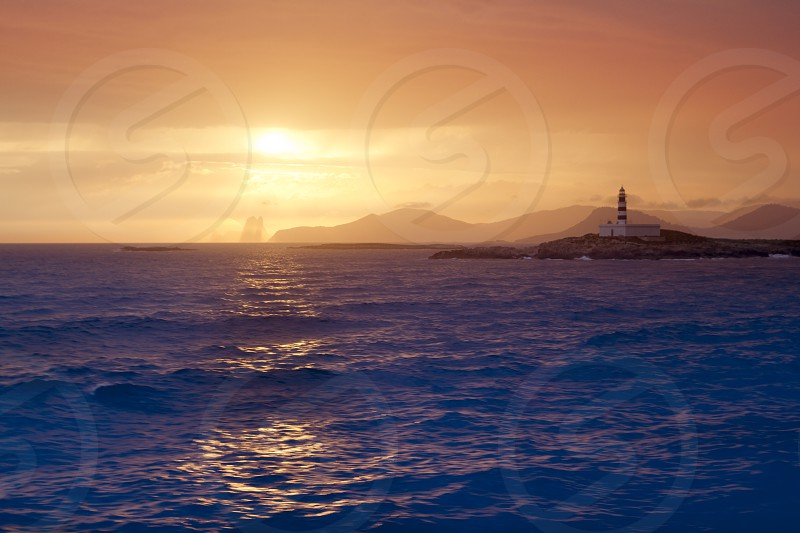 Ibiza formentera boat trip sunset Es Vedra Balearic Islands golden sky photo