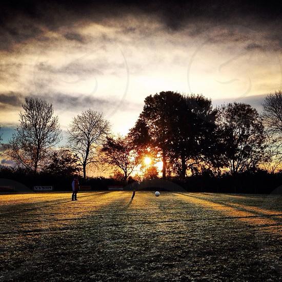 Sunlight ray of lights sunrise soccer photo