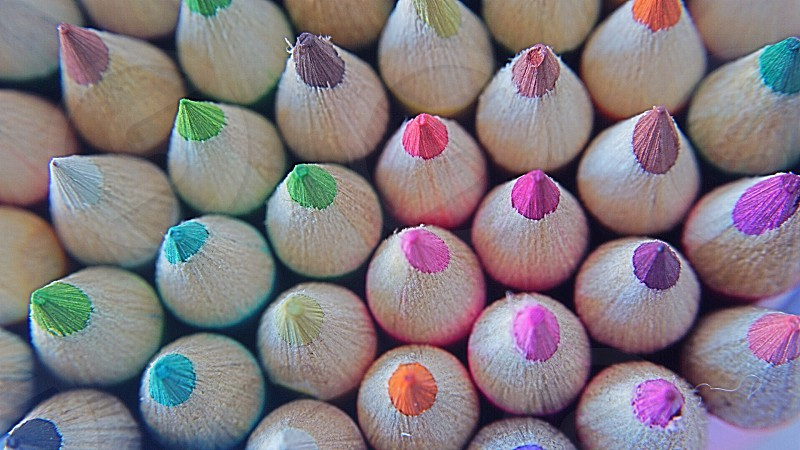 assorted colored sharpened coloring pencils photo