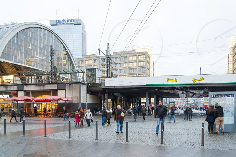 Commercial building transportation hub and tower are the landmark of Alexanderplatz inside Mitte Neighborhood in Berlin Germany  photo