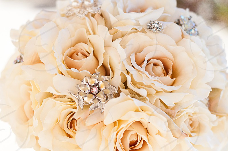 GOLD & WHITE | A bride's bouquet adorned with antique diamonds. photo