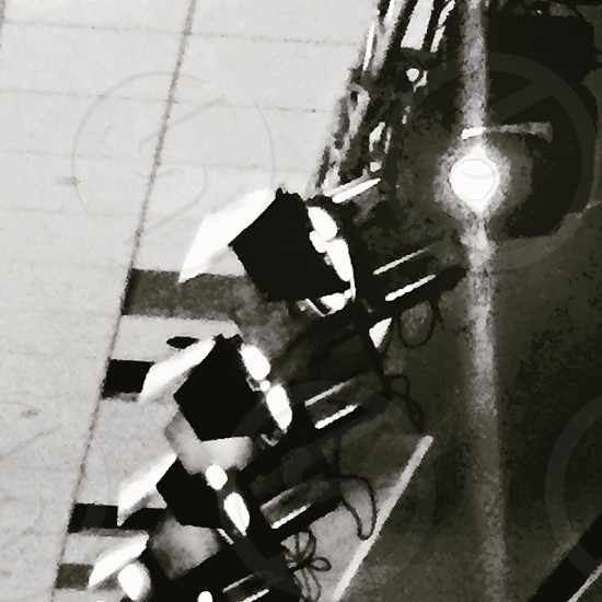 grayscale photo of track lights photo