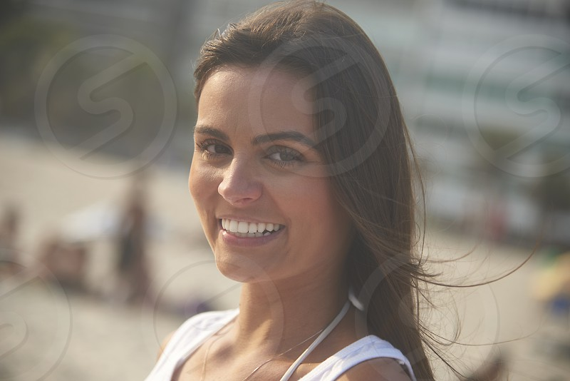 Portrait of  beautiful happy Brazilian woman in a white bikini top on the beaches in Rio de Janeiro photo