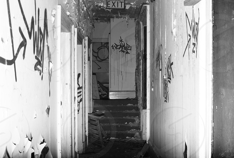 An annex corridor between two wards of an abandoned hospital in Leeds. photo