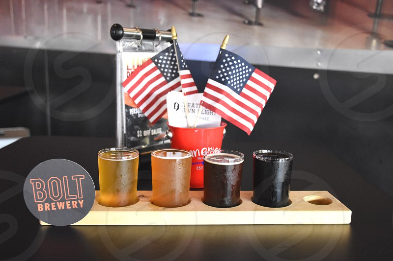 bolt brewery signage samples with u.s. flag lets on red cup display photo