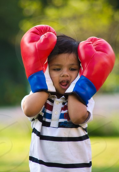 Happy young boxer in the park ;-) photo