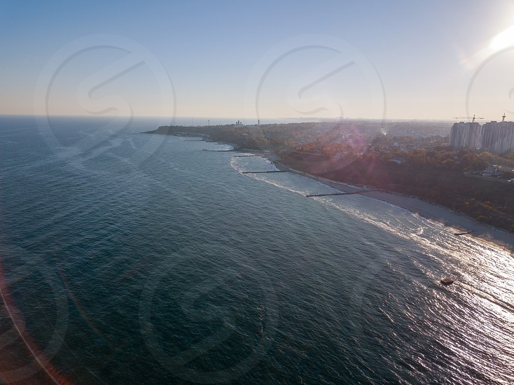 Panoramic bird's eye arial view from drone the coastline of a developed city Odesa Ukraine. Cityscape with modern building skyline of clear horizon. Place for text. photo
