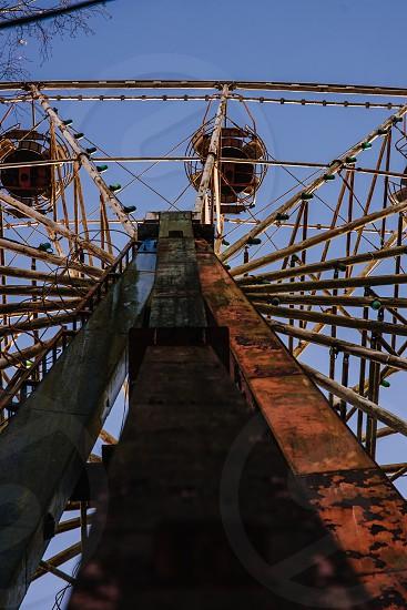 Shape of abandoned Ferris wheel photo