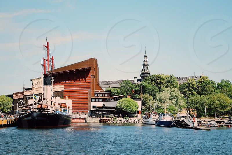 Water transports water transport ship ships boats masts ship museum marina Wasa ship museum Stockholm  Sweden building seaside port harbor photo
